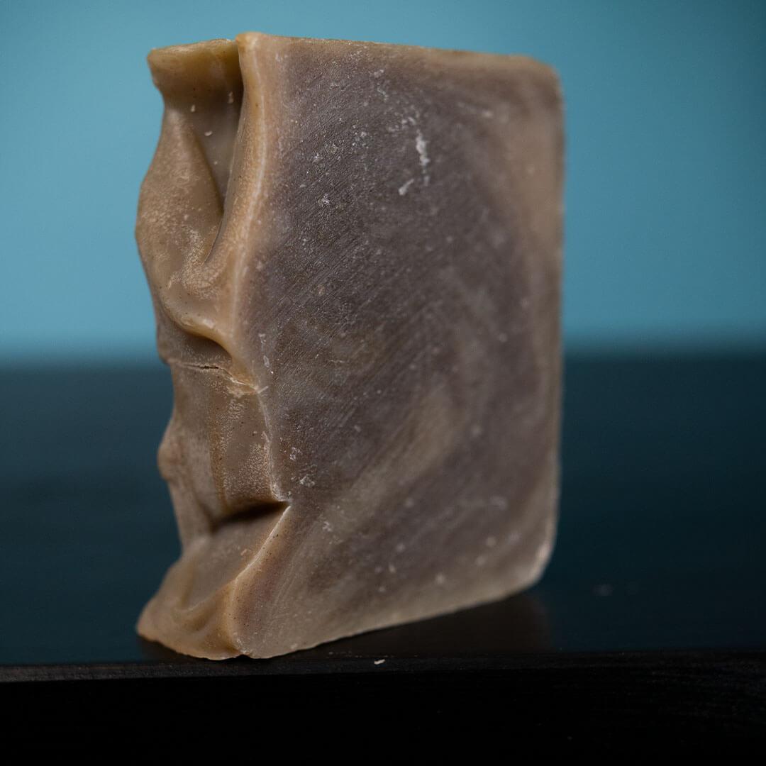 close up of sudsy shampoo bar | Pupford